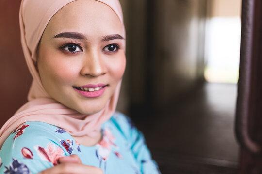 Portrait of a beautiful Asian Malay woman in hijab.