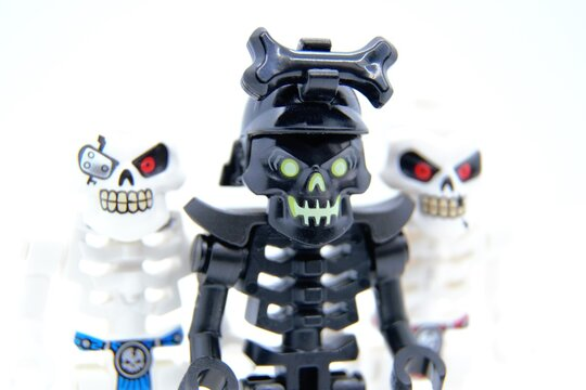 Lego Ninjago minifigures. The Awakened Warrior, also known as the Re-Awakened, black skeleton and Skulkin army warriors. Closeup, selective focus. Warsaw, Poland - March 3 2021