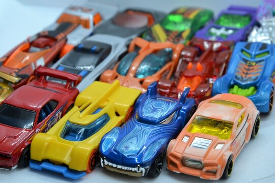 Mix of miniature, colorful toy cars. A lot of little toy car models, ready for play. Toy cars background. Warsaw, Poland - March 3 2021