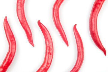 Red hot chili peppers on a white background. Vitamin vegetable food