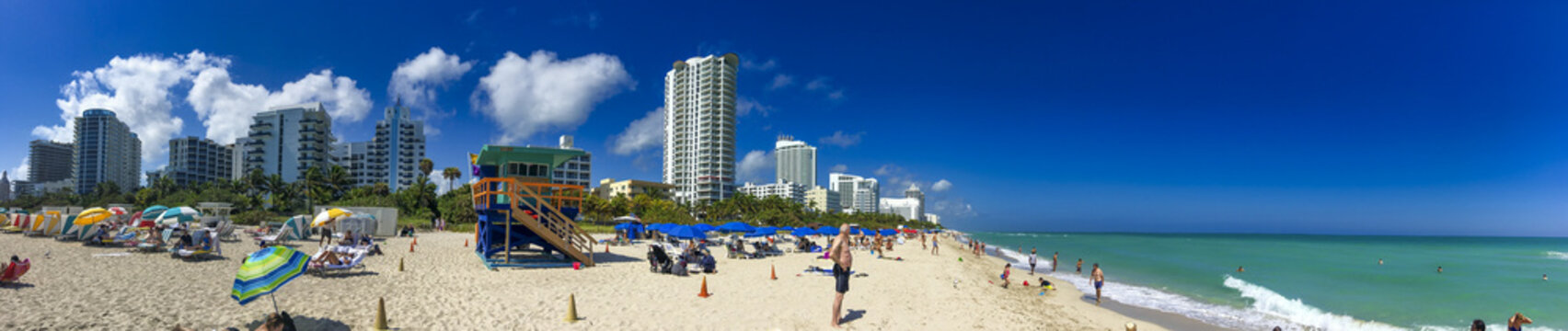 MIAMI BEACH, FL - FEBRUARY 2016: Tourists and locals enjoy the beautiful city beach