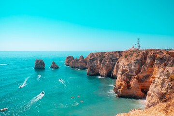 Landscape of cliffs surrounded by the sea under a blue sky and sunlight in Portugal