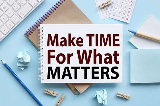 Make Time for What Matters. text on white notepad paper on blue background. near the blue sticks and a white keyboard