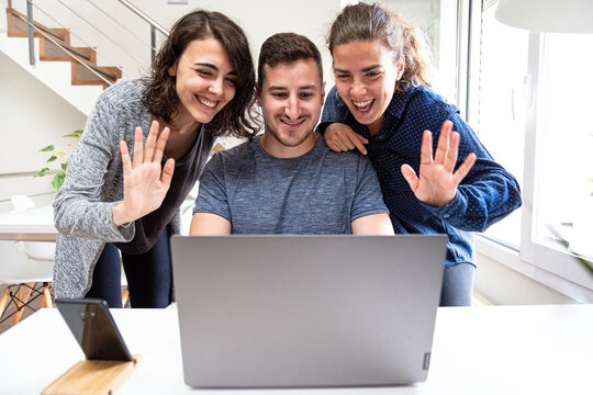group of friends waving in a video call