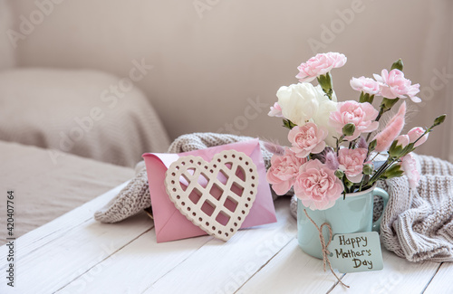 Cozy still life for Mother's Day with fresh flowers and decor details.