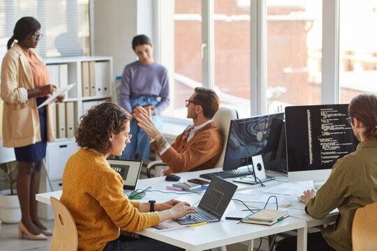 IT Development Team Working in Office