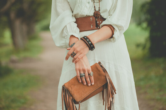 Brown handbag in the hands of a woman