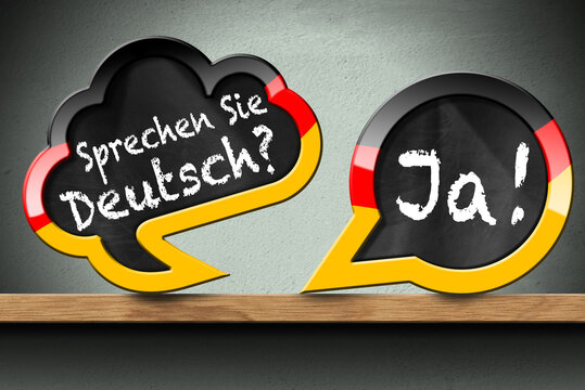 3D illustration of two speech bubbles with German flag and question, Sprechen Sie Deutsch? and Ja! (Do you speak German? and Yes!). On a wooden shelf with a wall on background.