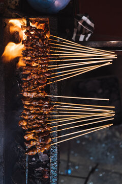 Closeup of asian street food meat skewers on the barbecue