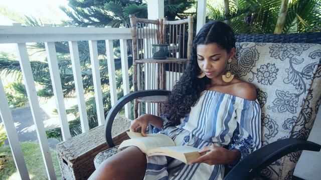 Woman reading book on deck
