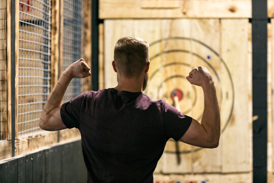 Man Excited After Hitting Bullseye With Hatchet