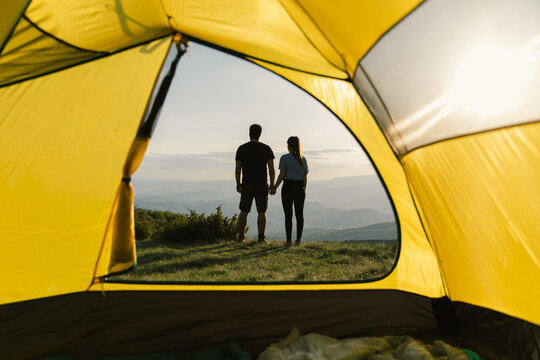 Young couple camping in mountain