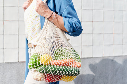 Woman walking with fresh groceries
