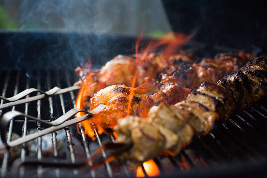 Close up of chicken shish kebabs on a grill