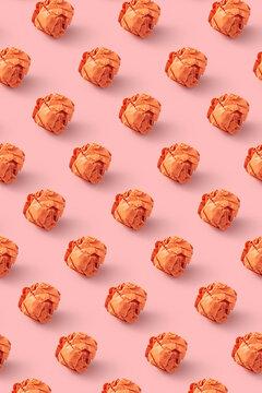 Crumpled orange paper balls pattern.