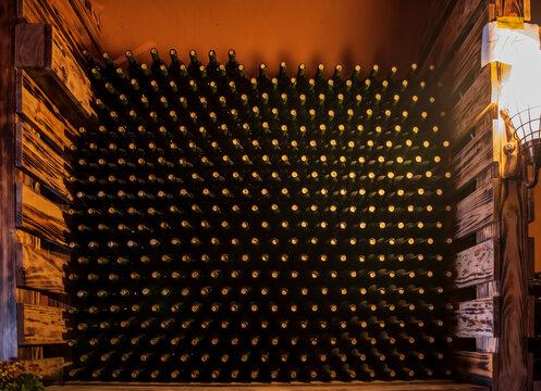 Wine bottles in wine cellar, row of glass bottles