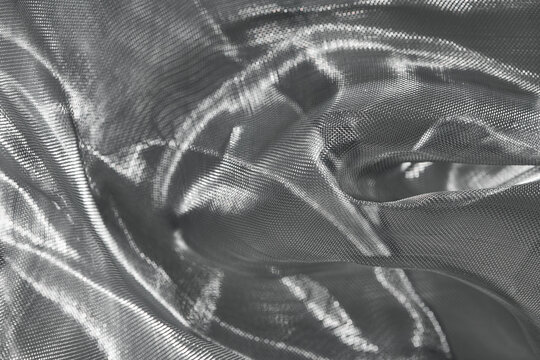Wrinkled shiny material of silver mesh