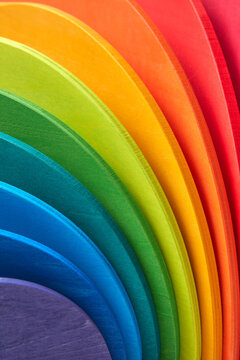 Wooden rainbow colored curved boards.