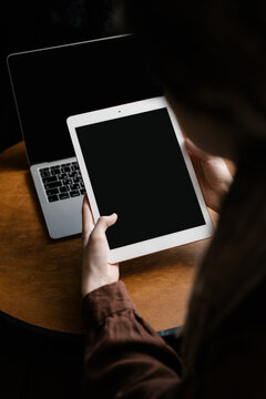 Woman working with laptop and tablet