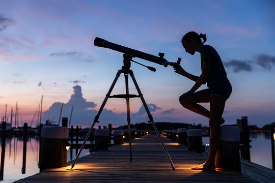 Landscape image of young aspiring Scientist with Telescope