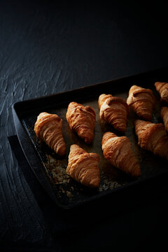 Several Croissants on a Baking sheet