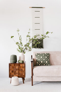 Living room decorated with flowers and knitted panel