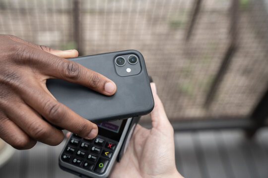 Crop View Of Man Using Cellphone For Paying