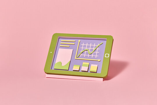 Papercraft tablet with graphic online presentation.