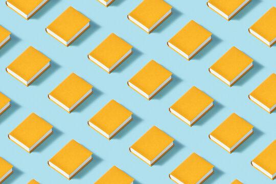 Paper yellow books diagonally arranged pattern.