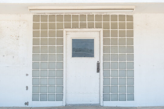 The doorway to a white building