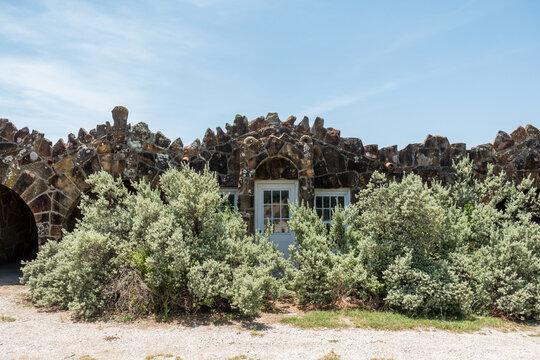 An overgrown stone house