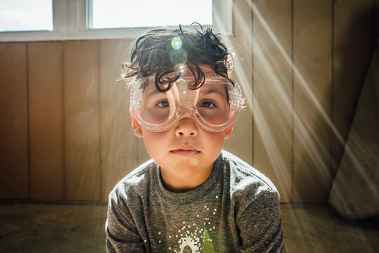 Boy wearing safety goggles.