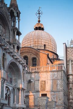 Sunset light reflecting on Saint Mark's Basilica in Venice.