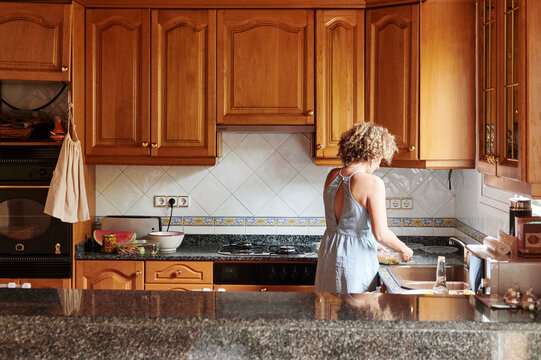 Mature woman making lunch at home