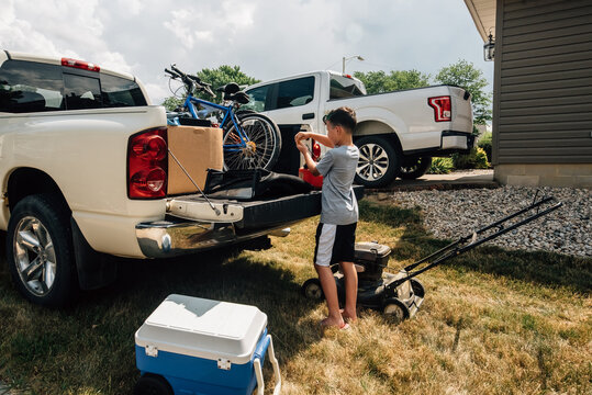Boy loading truck while moving.