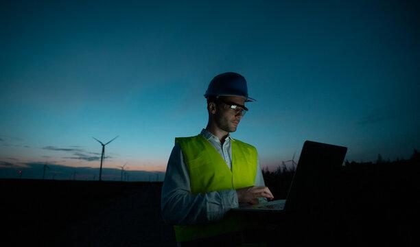 An engineer using a lap top computer