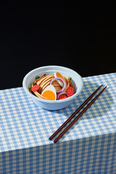 Bowl of asian noodle style soup with egg and tomato