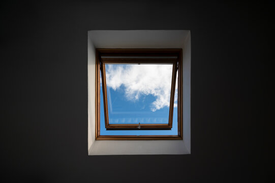 Skylight view with blue sky and clouds