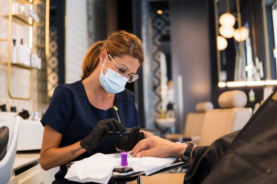 Manicurist working