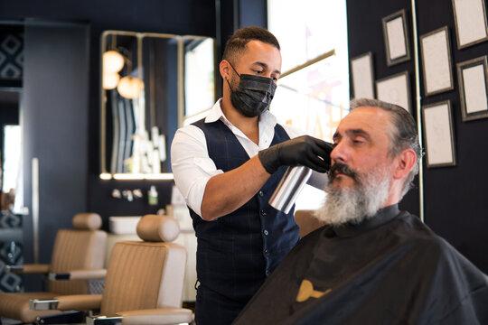Old man at hairdresser