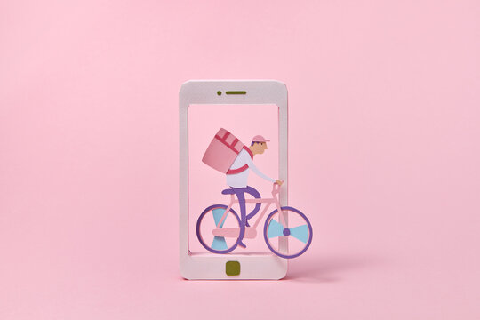 Paper courier on a bicycle riding through smartphone.