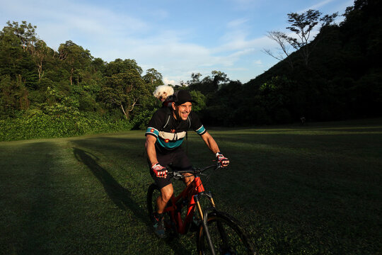 Mountainbiker and his dog out on a ride
