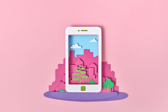 Papercraft smartphone on a background of craft city.
