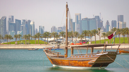 Qatar skyline along with traditional dhow. Wall mural