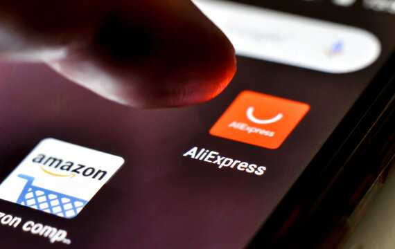 Finger pressing Aliexpress icon on mobile phone screen