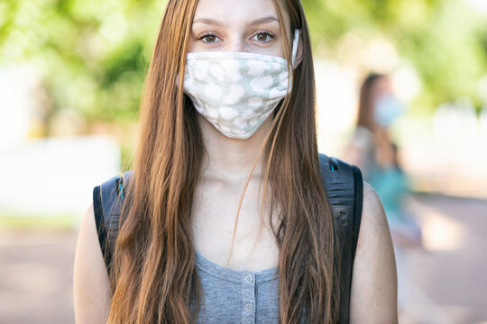 Covid: Serious Student With Face Mask Looks At Camera