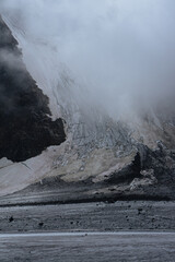snow-covered rock in a light fog