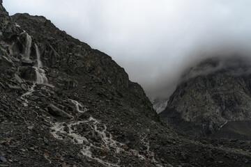 minimalistic mountain landscape. mountain river in misty rocky valley