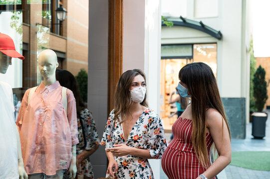 Pregnant lesbian couple doing shopping during quarantine