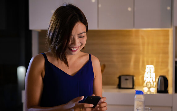 Woman typing message on her phone